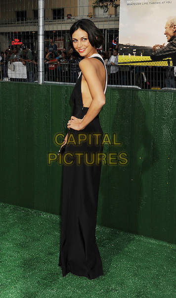 "Morena Baccarin.""Trouble With The Curve"" Los Angeles Premiere held at the Regency Village Theatre, Westwood, California, USA..September 19th, 2012.full length white hand on hip dress sleeveless side looking over shoulder black jumpsuit.CAP/ROT/TM.©Tony Michaels/Roth Stock/Capital Pictures"
