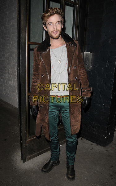 Luke Treadaway.The InStyle Best Of British Talent party, Shoreditch House, Ebor St., London, England..January 26th, 2012.full length shiny green trousers brown jacket coat beard facial hair suede fur.CAP/CAN.©Can Nguyen/Capital Pictures.
