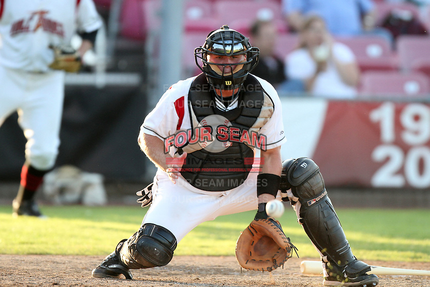 Salem-Keizer catcher Daniel Burkhart #15 fields a throw during a game against the Eugene Emeralds at Volcanoes Stadium on August 9, 2011 in Salem-Keizer,Oregon. Eugene defeated Salem-Keizer 13-7.(Larry Goren/Four Seam Images)