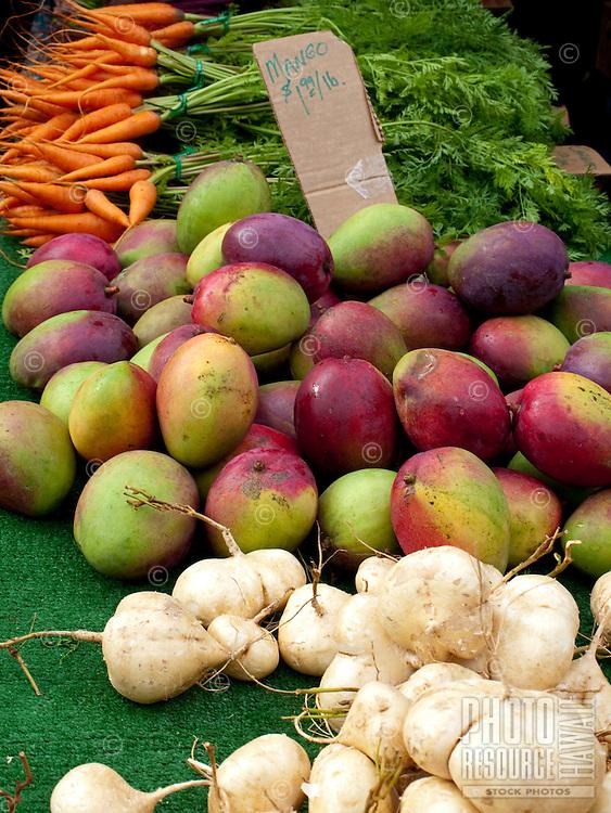 Fresh mangos and carrots sold at the Kapiolani Community College farmers market.