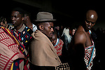 CAPE TOWN, SOUTH AFRICA JULY 2: Fashion designer Laduma Ngxolo of label MaXhosa by Laduma checks his models backstage before a show at South Africa Menswear week 2015 on July 2, 2015 in Cape Town, South Africa. The second edition of SAMW featured designers from South Africa and around Africa showing spring and summer collections during the 3-day event.  The label celebrates the rich heritage of the Xhosa culture using traditional Xhosa motifs and patterns for their range of knitted clothing. (Photo by Per-Anders Pettersson)