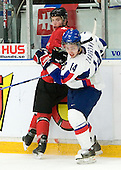 Tomas Zaborsky (Saginaw Spirit - Slovakia) hits Sebastian Schilt (Geneva Servette - Switzerland) along the boards. The Suisse defeated Slovakia 2-1 in a 2007 World Juniors match on January 2, 2007, at FM Mattson Arena in Mora, Sweden.
