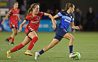 Portland, Oregon - Saturday July 9, 2016: FC Kansas City midfielder Mandy Laddish (7) dribbles past Portland Thorns FC midfielder Celeste Boureille (30) during a regular season National Women's Soccer League (NWSL) match at Providence Park.