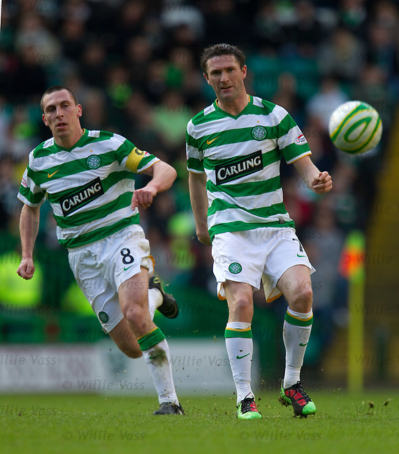Scott Brown watches Robbie Keane