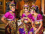 14 JULY 2016 - UBUD, BALI, INDONESIA:  Girls in a traditional Balinese legong dance troupe wait to perform during the mass cremation ceremony in Ubud. Local people in Ubud exhumed the remains of family members and burned their remains in a mass cremation ceremony Wednesday. Thursday was spent preparing for Saturday's ceremony that concludes the cremation and included traditional Balinese Legong dances performed in the evening. Almost 100 people will be cremated and laid to rest in the largest mass cremation in Bali in years this week. Most of the people on Bali are Hindus. Traditional cremations in Bali are very expensive, so communities usually hold one mass cremation approximately every five years. The cremation in Ubud will conclude Saturday, with a large community ceremony.  PHOTO BY JACK KURTZ