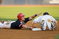 Matt Wessinger #0 of the St. John's Red Storm tries to call time after being tagged out by Keith Werman #2 of the Virginia Cavaliers after over-sliding second base in the championship game of the Charlottesville Regional at Davenport Field on June 5, 2010, in Charlottesville, Virginia.  The Cavaliers defeated the Red Storm 5-3.  Photo by Brian Westerholt / Four Seam Images