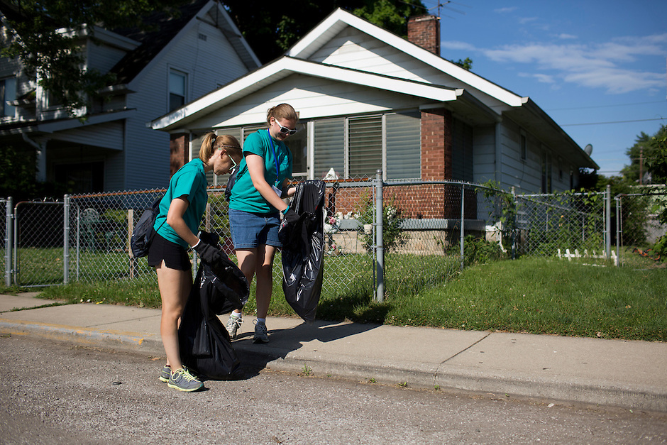 "Sally Finkel, left, and Molly Baumann pick up trash in the Hawthorne neighborhood during ""Circle the City with Service,"" the Kiwanis Circle K International's 2015 Large Scale Service Project, on Wednesday, June 24, 2015, in Indianapolis. (Photo by James Brosher)"