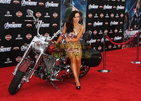 "Karina Smirnoff.""Marvel's The Avengers"" World Premiere held at the El Capitan Theatre, Hollywood, California, USA..April 11th, 2012.full length gold silver dress beads beaded embellished jewel encrusted sequins sequined sitting motorbike motorcycle bike.CAP/ADM/BP.©Byron Purvis/AdMedia/Capital Pictures."