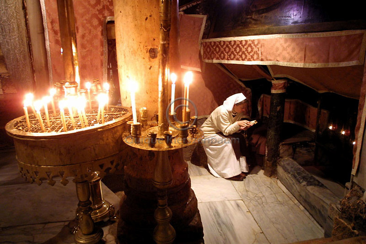 Sister Ann-Elisabeth from the Order of the Beatitudes in France prays December 20, 2001 in the Grotto of the Church of the Nativity, where according to tradition Jesus was born, in Bethlehem.
