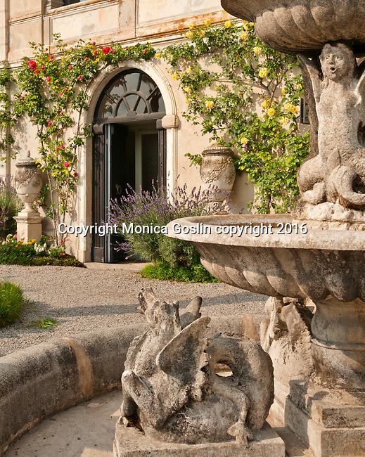 Fountain and gardens at Villa Monastero Gardens in Varenna, Italy on Lake Como