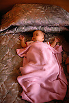 baby Claire asleep on bed in hotel room, Changzhou, China, Asia