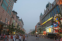 People walking in Wangfujing Mall at night, Beijing, China.