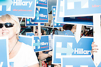 Supporters of Democratic presidential candidate Hillary Clinton get ready to march in the Labor Day parade in Milford, New Hampshire. Though Clinton did not march in the parade, Republican candidates John Kasich, Carly Fiorina, and Lindsey Graham, and Democratic candidate Bernie Sanders did march in the parade.