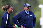 CARY, NC - APRIL 08: Former UNC player, the Courage's Jessica McDonald (left), with UNC (and Courage) assistant coach Bill Palladino (right). The NWSL's North Carolina Courage played a preseason game against the University of North Carolina Tar Heels on April 8, 2017, at WakeMed Soccer Park Field 3 in Cary, NC. The Courage won the match 1-0.