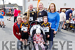 """James, Eve, Niamh, Jamie and Myrna Bulger, Keith O'Flynn and Dakota Carter O'Flynn at the Paul Lucey Memorial """"Run for the Rock"""" in the Austin Stack GAA Club on Monday morning."""