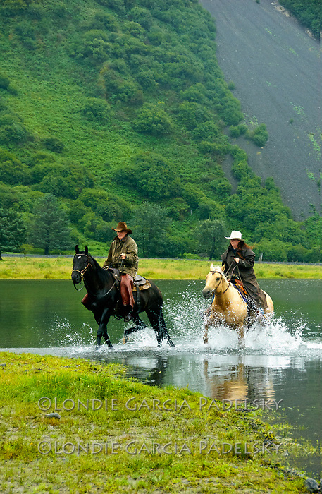 Horseback riding on the Pasagshak Ranch, Kodiak Island, Alaska. An island on the south coast of the U.S. state of Alaska. The largest island in the Kodiak Archipelago, and second largest in the U.S..