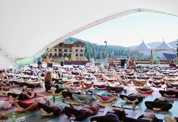 Yoga instructor Seane Corn teaches a vinyasa yoga class at Wanderlust. Seane Corn is an internationally renowned Vinyasa Flow yoga teacher and spiritual activist. She is well known for her passionate and inspirational style of teaching and the work that she is involved in throughout the world using yoga for positive social change. Wanderlust Festival is a yoga and music festival held annually in Squaw Valley California.