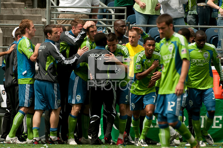 Sebastien Le Toux (9) of the Seattle Sounders gets congratulated by his teammates after scoring at Quest Field on May 10, 2009. The Sounders and Galaxy played to a 1-1 draw.
