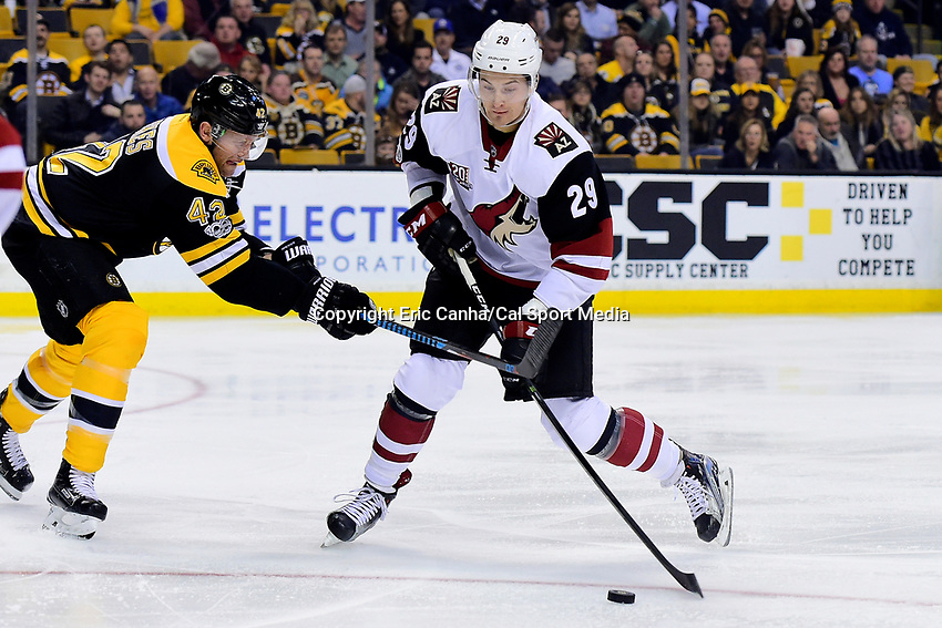 Tuesday, February 28, 2017: Boston Bruins right wing David Backes (42) works to stick check Arizona Coyotes left wing Brendan Perlini (29) during the National Hockey League game between the Arizona Coyotes and the Boston Bruins held at TD Garden, in Boston, Mass. Eric Canha/CSM