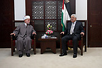 Palestinian President Mahmoud Abbas meets with the Mufti of Jerusalem, Sheikh Mohammed Hussein, in the West Bank city of Ramallah on June 26, 2017. Photo by Osama Falah