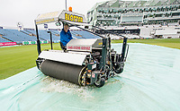 Picture by Allan McKenzie/SWpix.com - 13/04/2018 - Cricket - Specsavers County Championship - Yorkshire County Cricket Club v Essex County Cricket Club - Emerald Headingley Stadium, Leeds, England - Yorkshire Groundsman Andy Foggarty on the Blotter taking up water on the first day of the Specsavers County Championship.