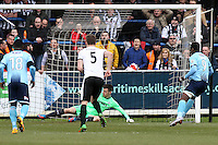 Omar Boggle of Grimsby Town (right) scores from the penalty spot during the Vanarama National League match between Dover Athletic and Grimsby Town at the Crabble Athletic Ground, Dover, England on 16 April 2016. Photo by Tony Fowles.