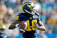 January 01, 2011:   Michigan Wolverines quarterback Denard Robinson (16) drops back to pass during first half action during the Progressive Gator Bowl action between the Mississippi State Bulldogs and the Michigan Wolverines at EverBank Field in Jacksonville, Florida.
