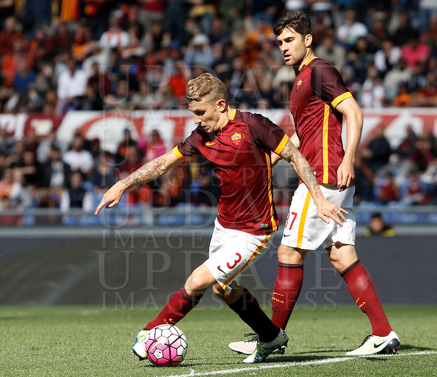 Calcio, Serie A: Roma vs Napoli. Roma, stadio Olimpico, 25 aprile 2016.<br /> Roma's Lucas Digne, left, in action past his teammate Diego Perotti during the Italian Serie A football match between Roma and Napoli at Rome's Olympic stadium, 25 April 2016. <br /> UPDATE IMAGES PRESS/Isabella Bonotto