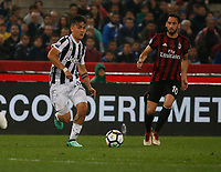 Paulo Dyabala of Juventus and Hakan Calhanoglu   during the  Coppa Italia ( Tim Cup) final soccer match,  Ac Milan  - Juventus Fc       at  the Stadio Olimpico in Rome  Italy , 09 May 2018