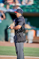 Home plate umpire Kai Nakamura before the game between the Ogden Raptors and the Rocky Mountain Vibes at Lindquist Field on July 6, 2019 in Ogden, Utah. The Vibes defeated the Raptors 7-2. (Stephen Smith/Four Seam Images)