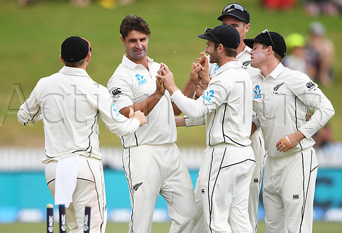 10th December 2017, Seddon Park, Hamilton, New Zealand; International Test Cricket, 2nd Test, Day 2, New Zealand versus West Indies;  Colin de Grandhomme and team mates celebrate the wicket of Chase