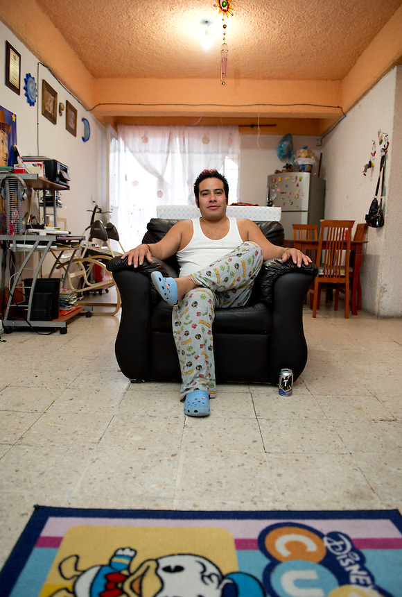 """Maximo a Lucha Libre wrestler is an """"Exotico"""" meaning he fights as a gay Luchador wakes up at his home after a night of wrestling with his wife India Siux and children. Mexico City"""