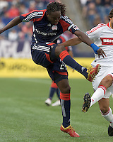 New England Revolution midfielder Shalrie Joseph (21) shoots as Chicago Fire midfielder Baggio Husidic (9) defends. The New England Revolution out scored the Chicago Fire, 2-1, in Game 1 of the Eastern Conference Semifinal Series at Gillette Stadium on November 1, 2009.