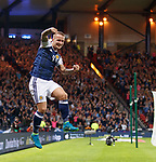 Leigh Griffiths scores the second goal for Scotland and celebrates