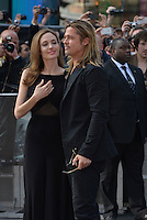 Angelina Jolie, Brad Pitt<br /> 'World War Z' world premiere, Empire cinema, Leicester Square, London, England 2nd June 2013 <br /> half length black dress suit side profile goatee facial hair couple <br /> CAP/PL<br /> &copy;Phil Loftus/Capital Pictures /MediaPunch ***NORTH AND SOUTH AMERICAS ONLY***