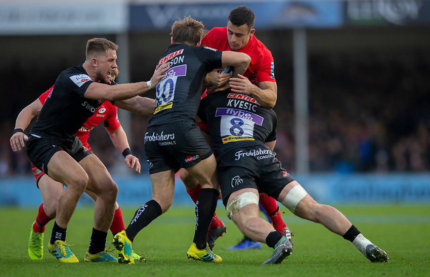 Saracens' Alex Lozowski is tackled by Exeter Chiefs' Matt Kvesic and Gareth Steenson<br /> <br /> Photographer Bob Bradford/CameraSport<br /> <br /> Gallagher Premiership Round 10 - Exeter Chiefs v Saracens - Saturday 22nd December 2018 - Sandy Park - Exeter<br /> <br /> World Copyright © 2018 CameraSport. All rights reserved. 43 Linden Ave. Countesthorpe. Leicester. England. LE8 5PG - Tel: +44 (0) 116 277 4147 - admin@camerasport.com - www.camerasport.com