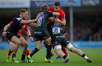 Saracens' Alex Lozowski is tackled by Exeter Chiefs' Matt Kvesic and Gareth Steenson<br /> <br /> Photographer Bob Bradford/CameraSport<br /> <br /> Gallagher Premiership Round 10 - Exeter Chiefs v Saracens - Saturday 22nd December 2018 - Sandy Park - Exeter<br /> <br /> World Copyright &copy; 2018 CameraSport. All rights reserved. 43 Linden Ave. Countesthorpe. Leicester. England. LE8 5PG - Tel: +44 (0) 116 277 4147 - admin@camerasport.com - www.camerasport.com