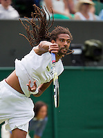 26-06-13, England, London,  AELTC, Wimbledon, Tennis, Wimbledon 2013, Day two, Dustin Brown (GER)<br /> <br /> <br /> <br /> Photo: Henk Koster