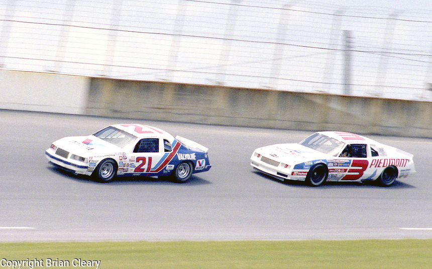 Buddy Baker 21 Ricky Rudd 3 action Firecracker 400 at Daytona International Speedway in Daytona Beach, FL on July 4, 1983. (Photo by Brian Cleary/www.bcpix.com)