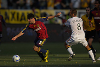 Alecko Eskandarian runs by Peter Vagenas. The Los Angeles Galaxy defeated Real Salt Lake, 3-2, at the Home Depot Center in Carson, CA on Sunday, June 17, 2007.