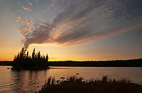 The sun sets over Tobin Lake on Isle Royale in Lake Superior, Isle Royale National Park, Keweenaw County, Michigan