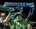 Seattle Sounders fans waves banners, flags and scarfs during their game against the Colorado Rapids during an MLS match on April 26, 2014 in Seattle, Washington.  The Seattle Sounders beat the Colorado Rapids 4-1.  Jim Bryant Photo. ©2014. All Rights Reserved.