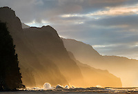 Wave on Napali Coast at sunset from Kea Beach. Kauai, Hawaii