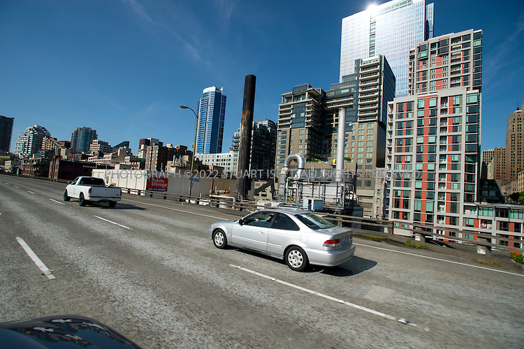 5/6/2012--Seattle, WA, USA..Riding on the upper deck of the Alaskan Way Viaduct in downtown Seattle, WASH., heading northbound on Highway 99. The viaduct, after 60 years since it was built along Seattle's waterfront over looking Elliot Bay and Puget Sound, will soon be torn down...©2012 Stuart Isett. All rights reserved.