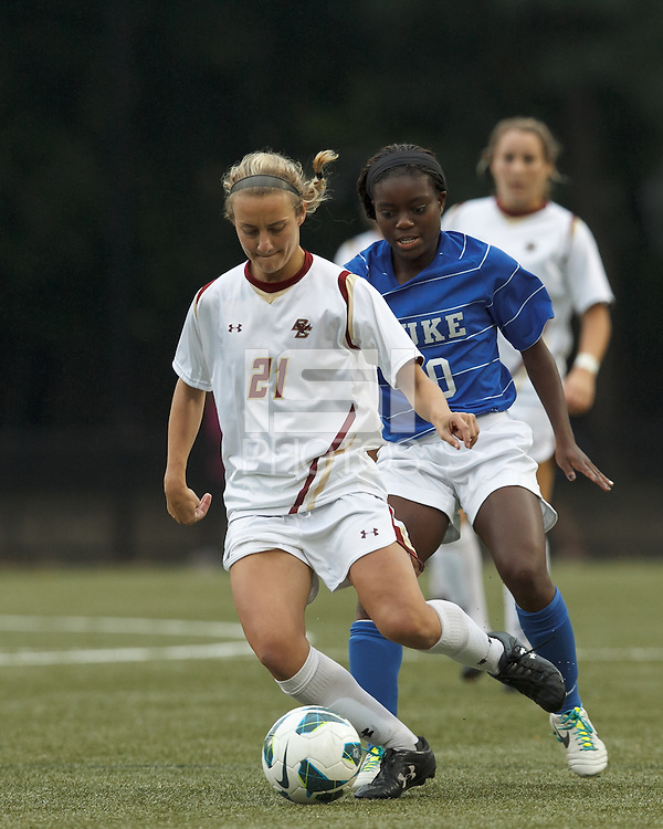 Boston College midfielder Kate McCarthy (21) dribbles as Duke University midfielder Toni Payne (10) pressures.Boston College (white) defeated Duke University (blue/white), 4-1, at Newton Campus Field, on October 6, 2013.