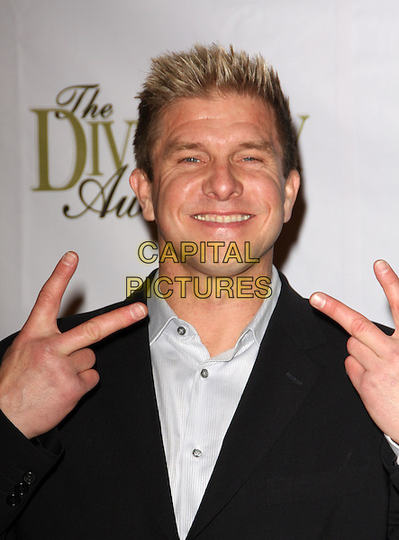 KENNY JOHNSON.Multicultural Motion Picture Association's 16th Annual Diversity Awards held at the Globe Theater, Universal City, California, USA..November 23rd, 2008.headshot portrait black hands fingers v peace sign rude gesture .CAP/ADM/KB.©Kevan Brooks/AdMedia/Capital Pictures.