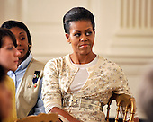 Washington, DC - November 24, 2009 -- First lady Michelle Obama listens to remarks as she hosts young women from the White House Leadership and Mentoring Program in the State Dining Room of the White House on Tuesday, November 24, 2009.  Earlier, the first lady made remarks on the history and protocol of State and Official Dinners at the White House..Credit: Ron Sachs / CNP.(RESTRICTION: NO New York or New Jersey Newspapers or newspapers within a 75 mile radius of New York City)