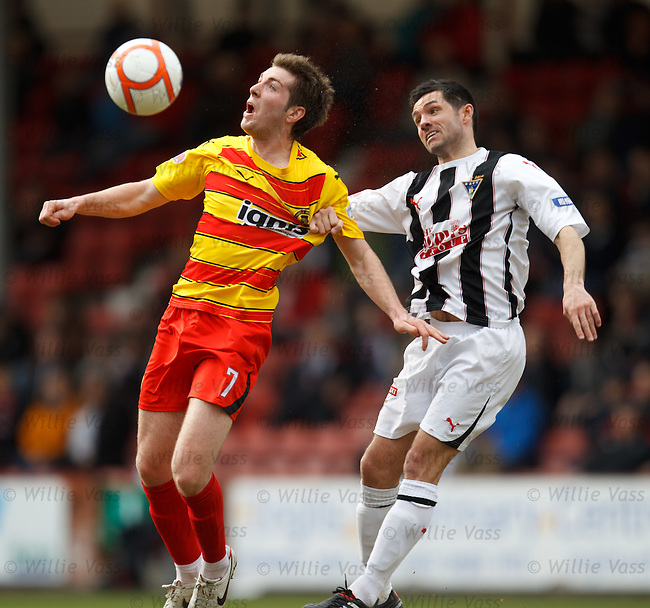 Iain Flannigan shields the ball from Gary Mason