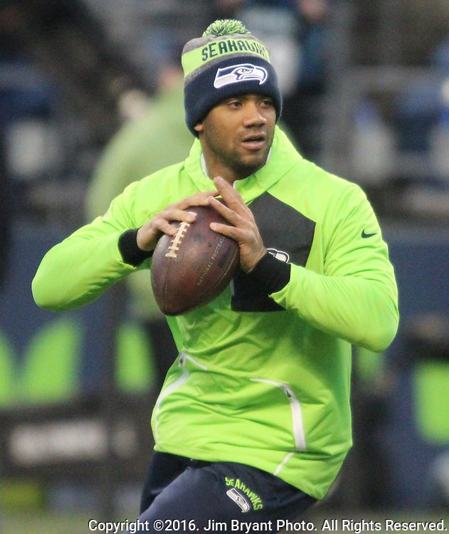 Seattle Seahawks quarterback Russell Wilson (3) warms up at before their game against the Carolina Panthers at CenturyLink Field in Seattle, Washington on December 4, 2016.  Seahawks beat the Panthers 40-7.  ©2016. Jim Bryant photo. All Rights Reserved.