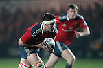 Second row Billy Holland of Munster Rugby carries the ball forwards for Munster.<br /> <br /> Guiness Pro 12<br /> Newport Gwent Dragons v Munster Rugby<br /> Rodney Parade<br /> 21.11.14<br /> &copy;Steve Pope-SPORTINGWALES